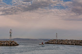 Fisherman in small boat leaving Chios harbor