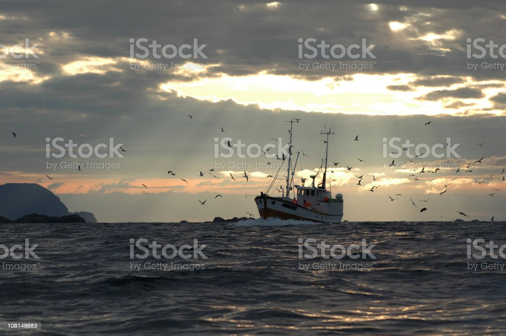 Fisherman in sunlight stock photo