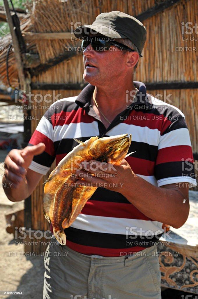 Fisherman in the Danube delta, Romania stock photo
