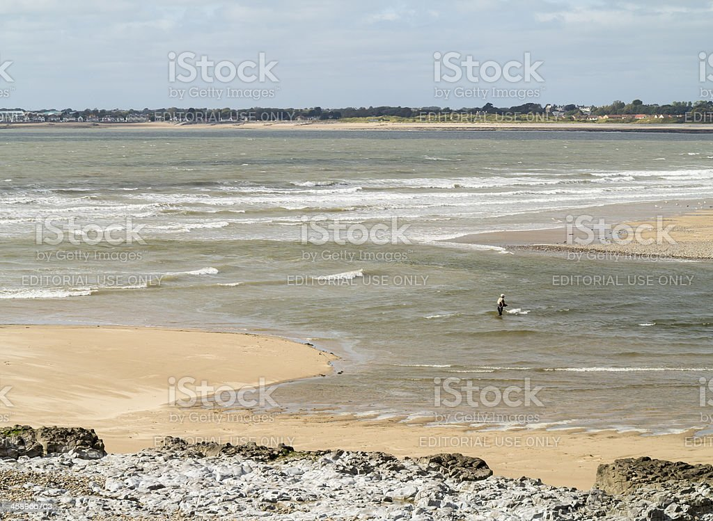 Fisherman in the River Ogmore, South Wales stock photo
