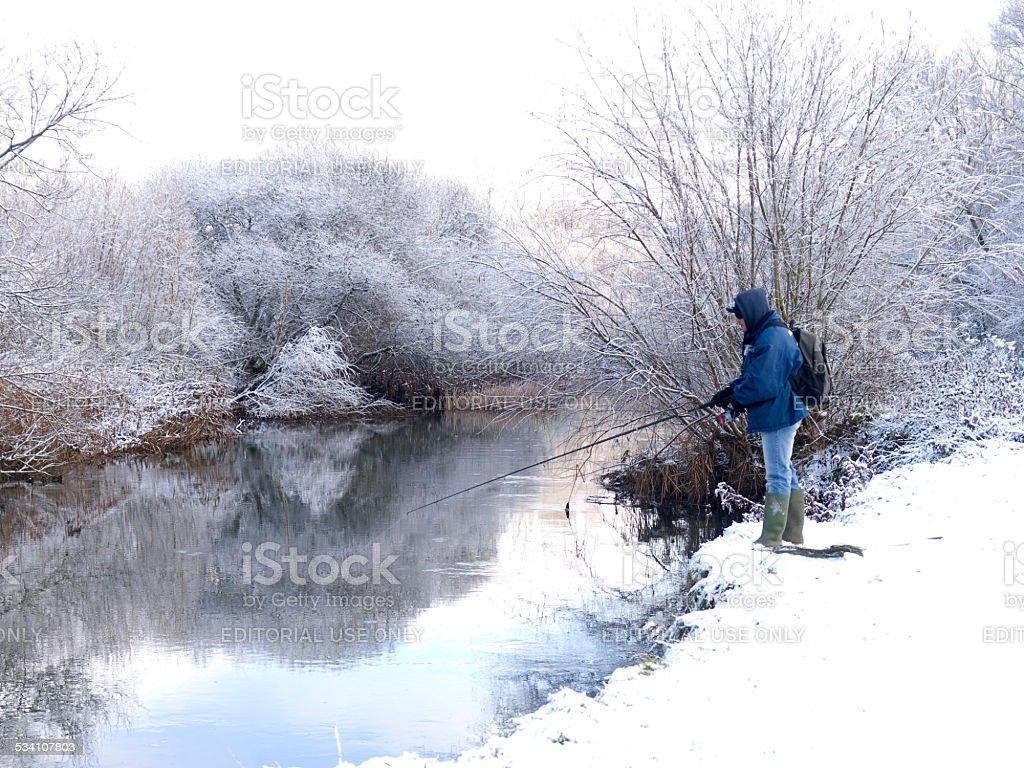 Fisherman in the snow stock photo