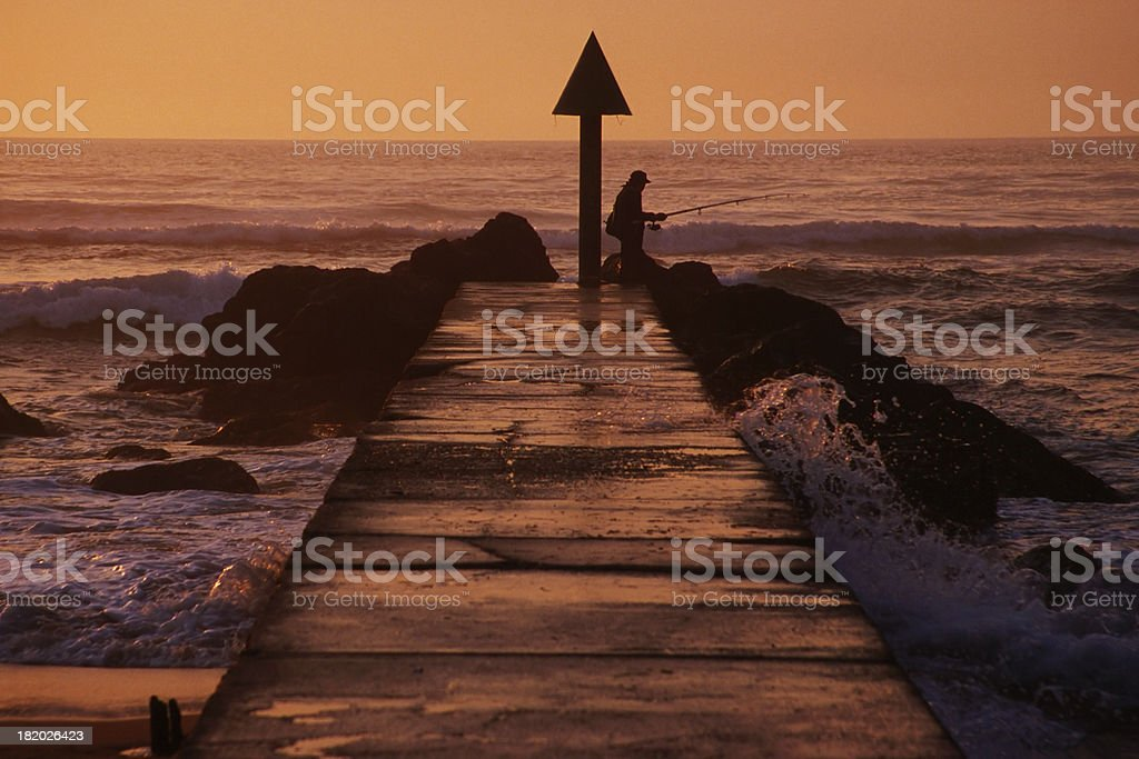 Fisherman in the sunset royalty-free stock photo