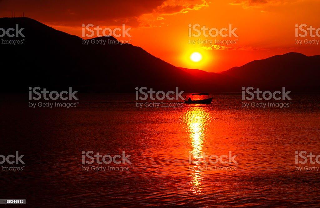 Fisherman, Industrial Ship, Beach, Fishing, Sunrise - Dawn stock photo