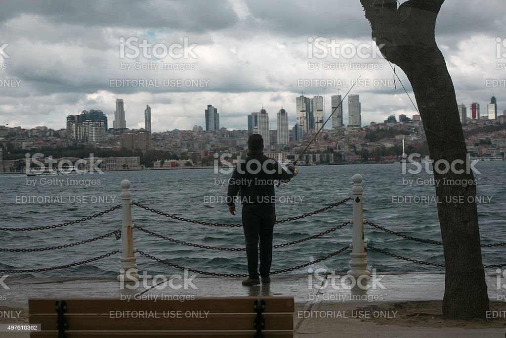 fisherman is catching fish with angler at istanbul turkey stock photo