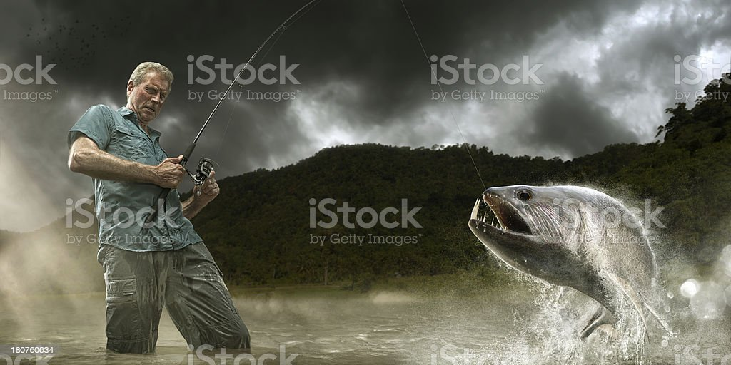 Fisherman Lands Dangerous Payara Fish in Amazon stock photo