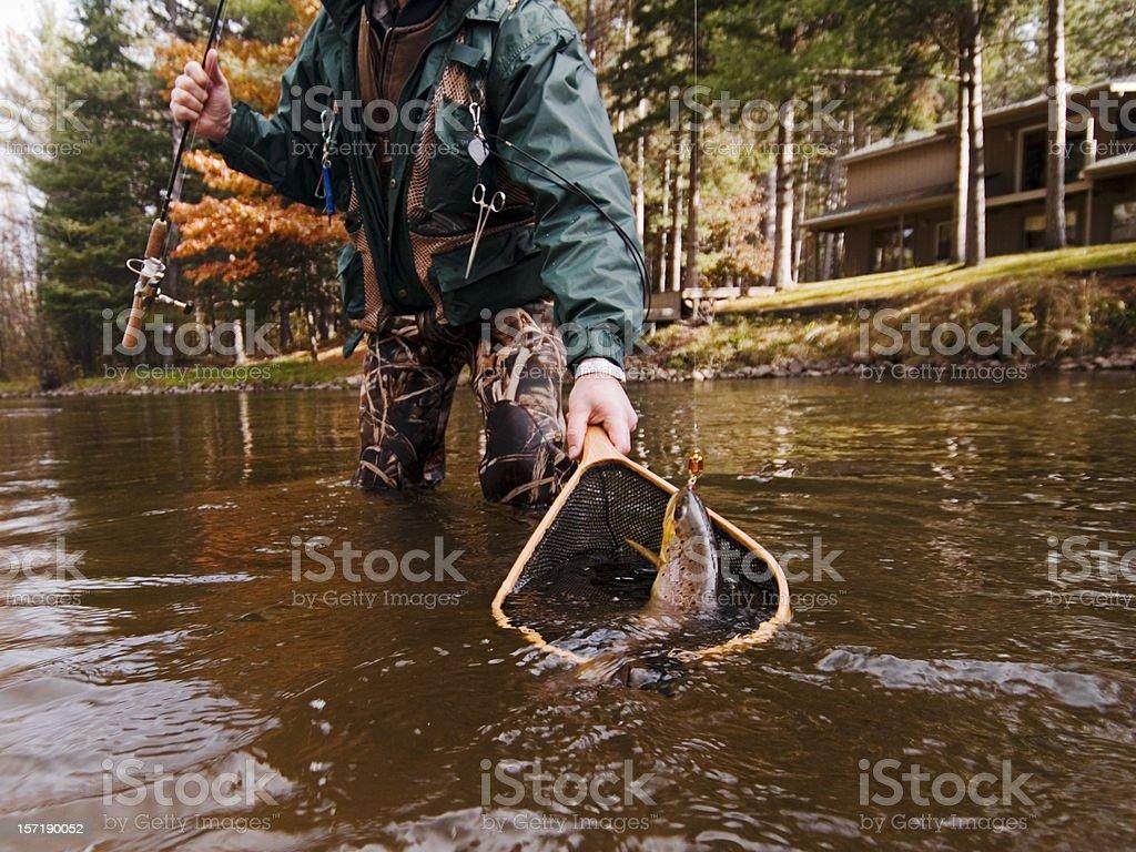 Fisherman Nets a Trout stock photo
