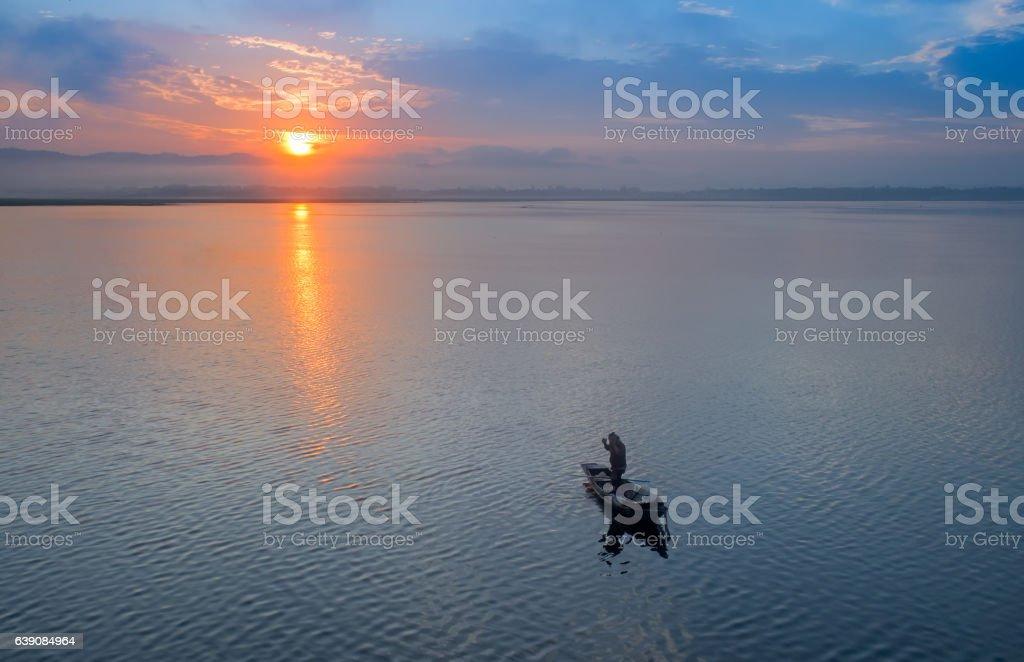 Fisherman of Bangpra Lake in action when fishing, stock photo
