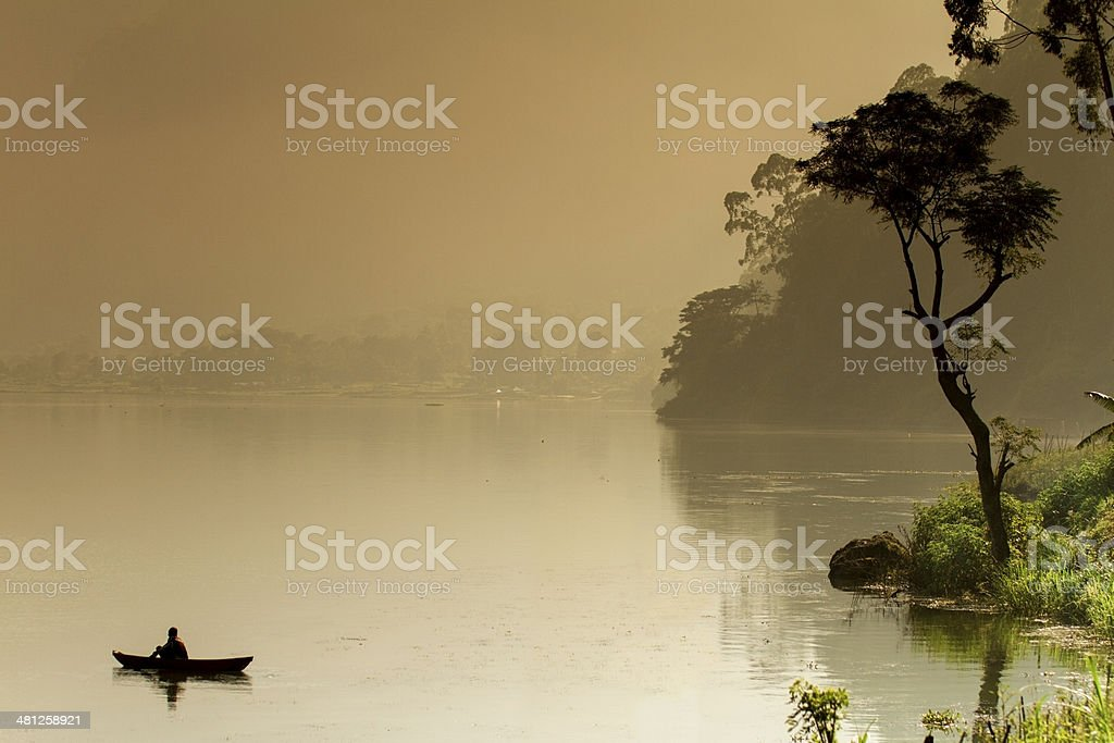 Fisherman on a boat in Bali royalty-free stock photo