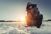 Fisherman on a winter lake
