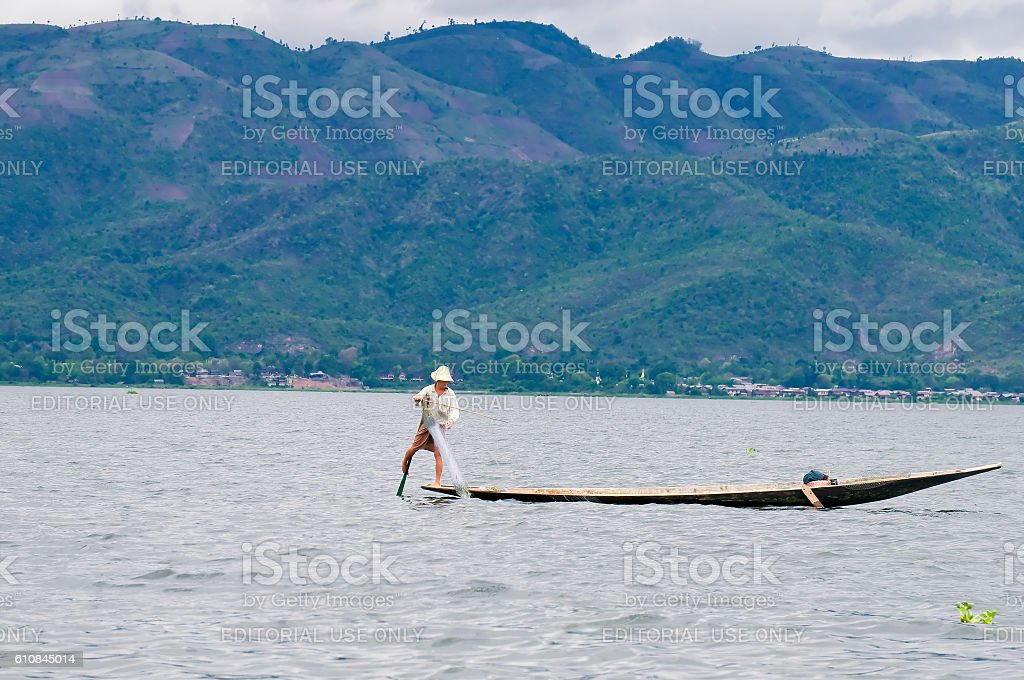 Fisherman on boat in traditional way in Inle lake, Myanmar stock photo