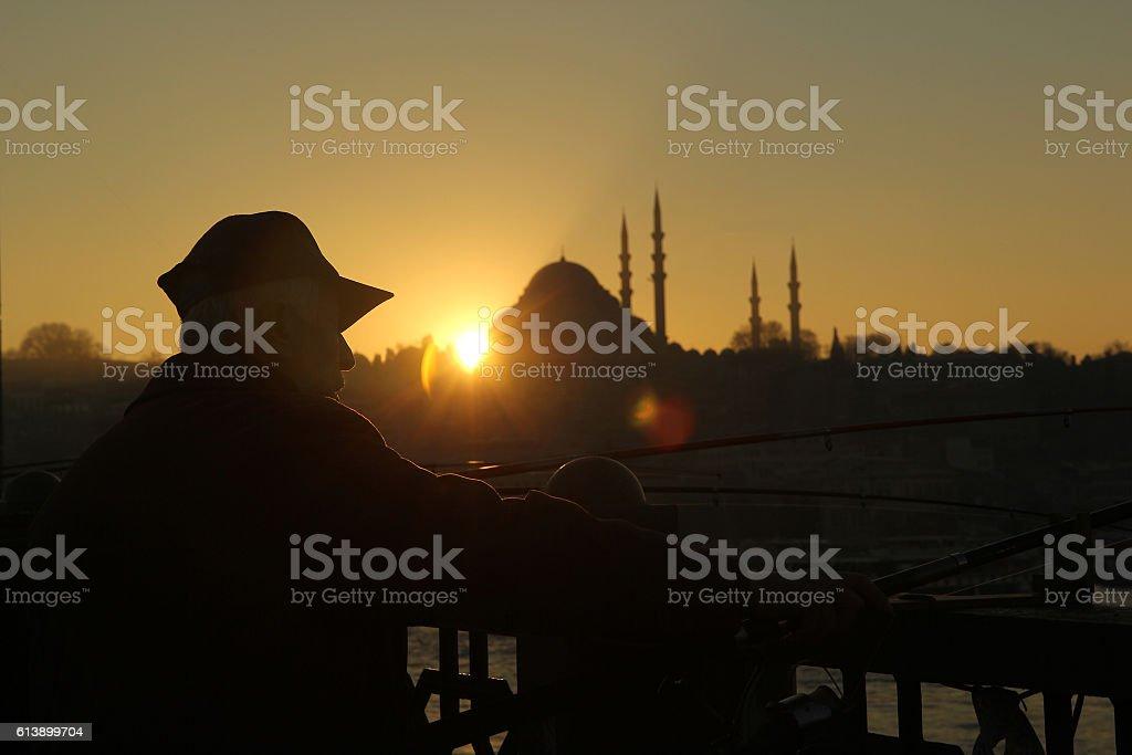 fisherman on galata bridge stock photo