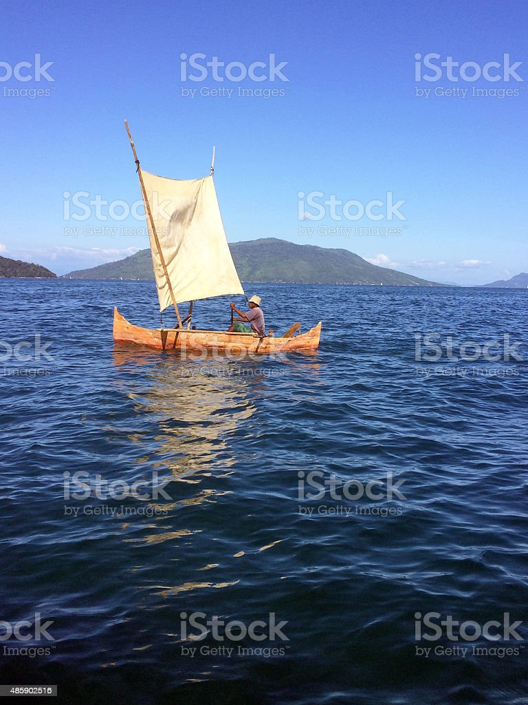 Fisherman on his macoro boat stock photo
