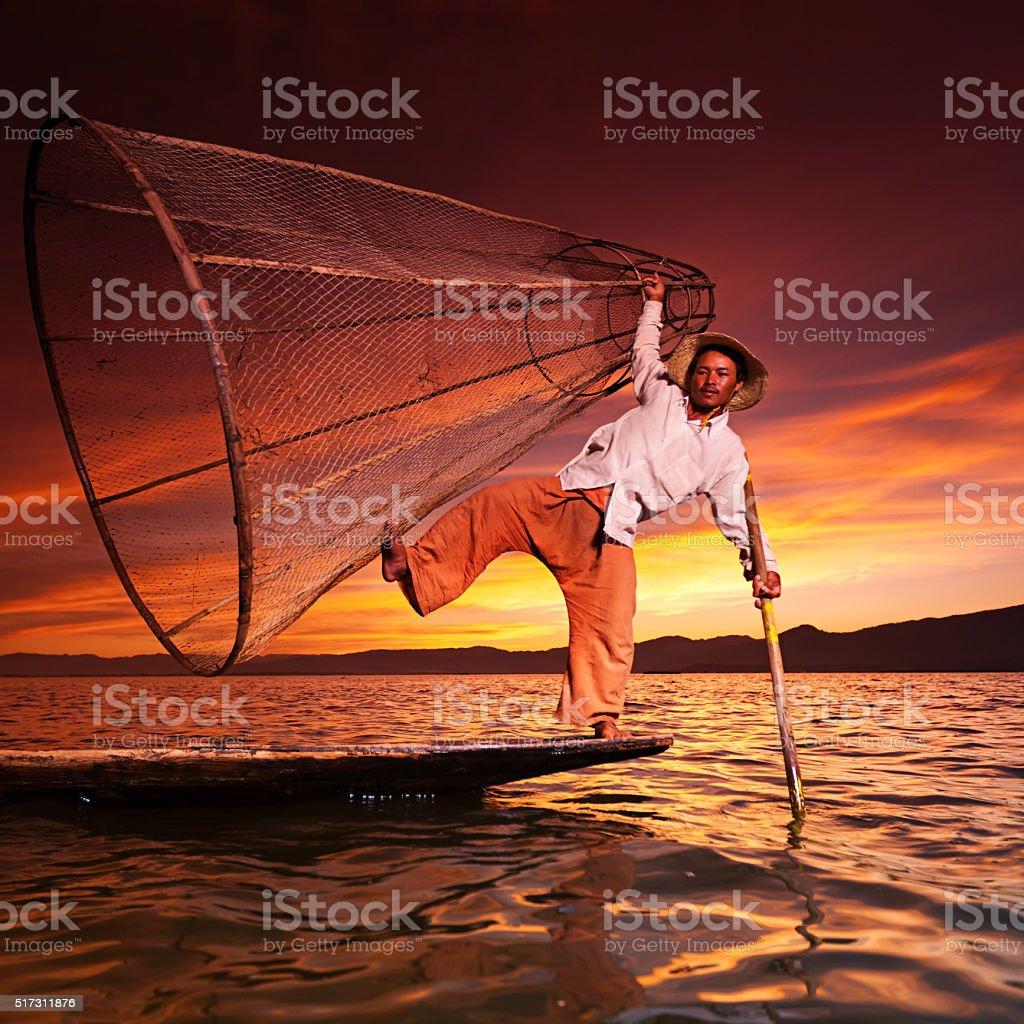 Fisherman on Inle Lake during sunset, Myanmar stock photo