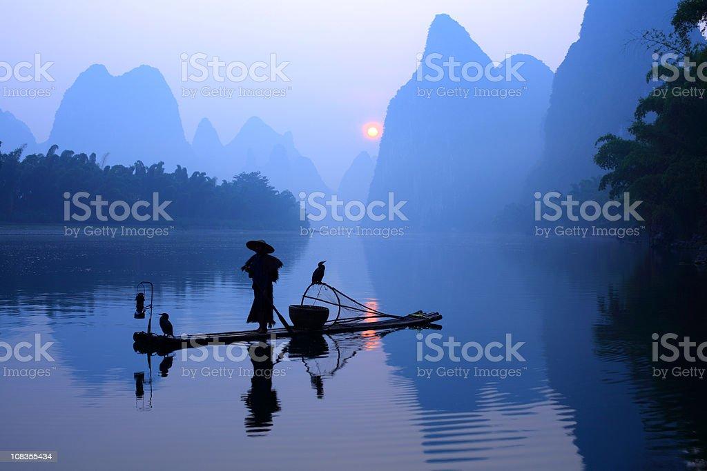 Fisherman on Li River stock photo