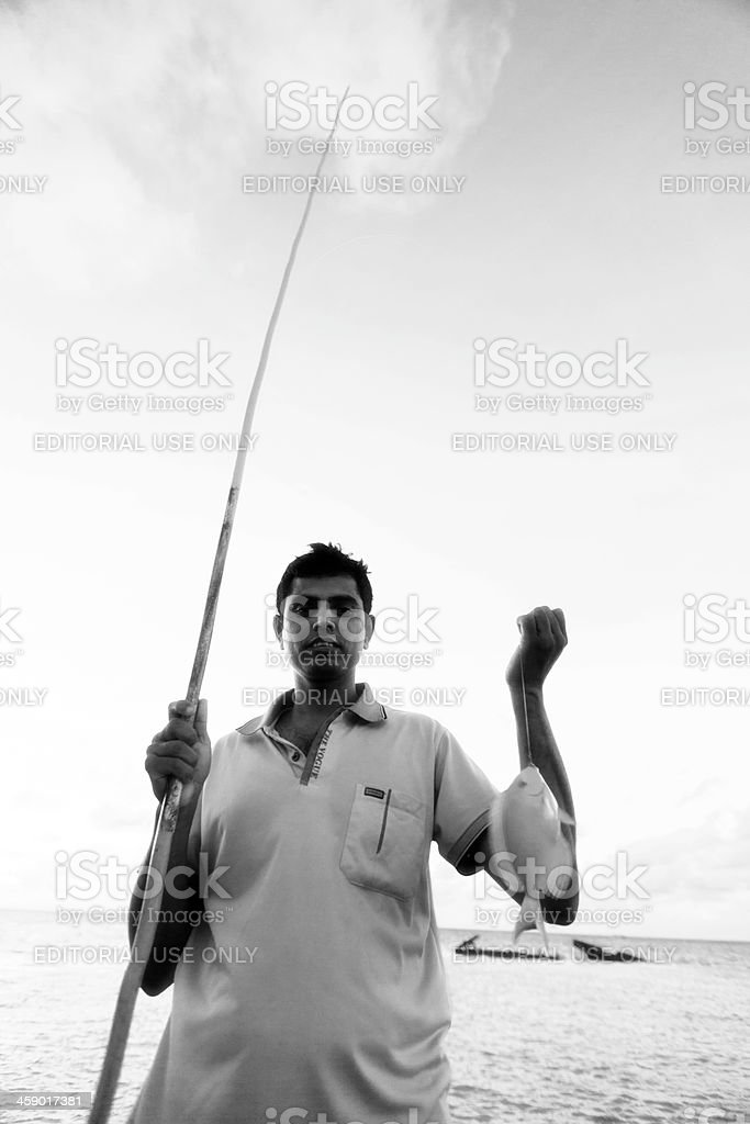 Fisherman on pier royalty-free stock photo