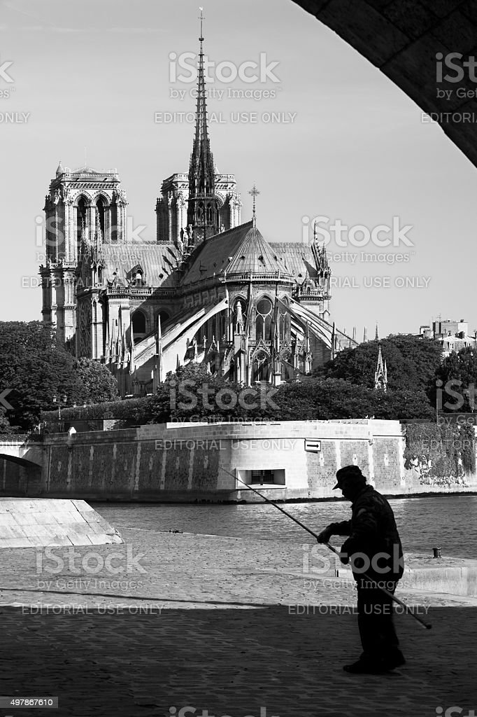 Fisherman on river Seine and Notre Dame de Paris, Paris royalty-free stock photo