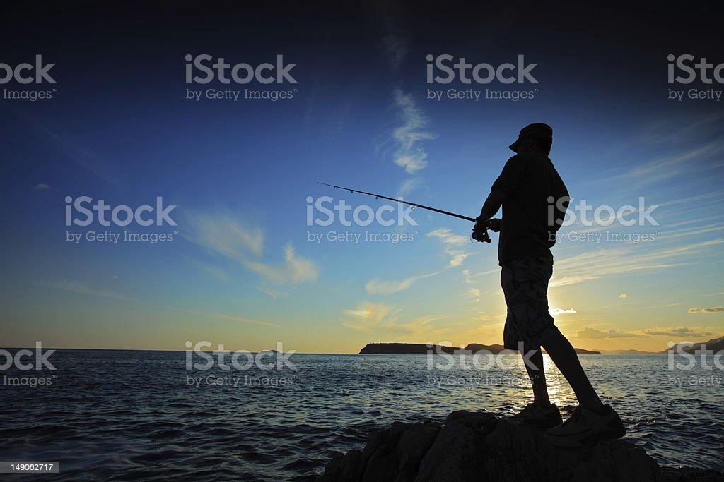 Fisherman on sunset stock photo