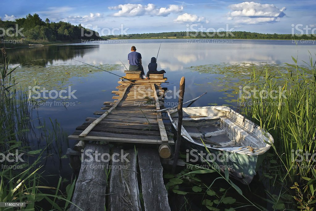 Fisherman on the lake stock photo