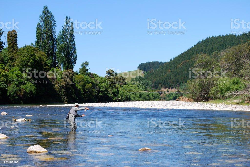 Fisherman on the Motueka River, Tasman, New Zealand royalty-free stock photo