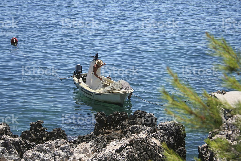 fisherman on the see royalty-free stock photo