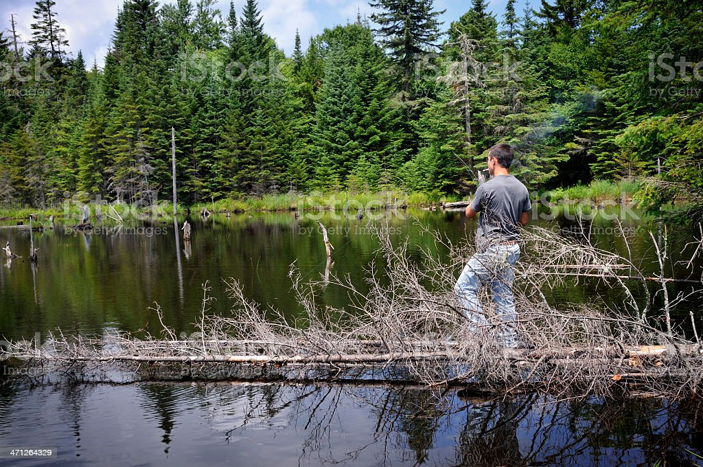 Fisherman Out on a Limb - Go Anywhere for Trout! royalty-free stock photo
