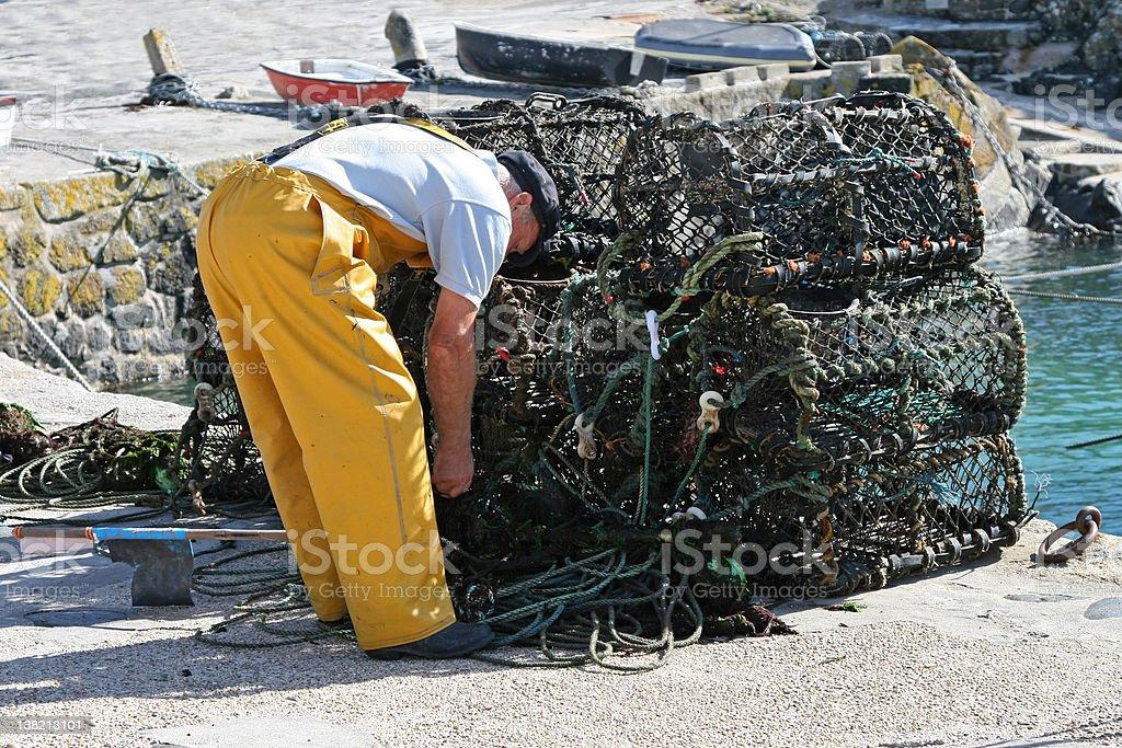 Fisherman Preparing His Nets royalty-free stock photo