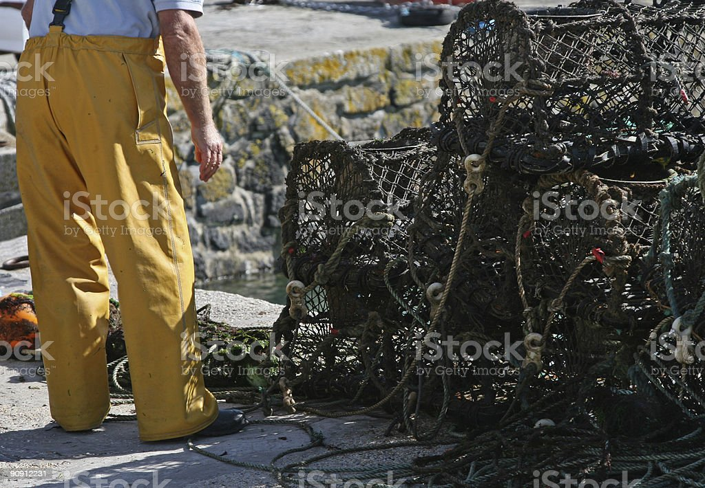 Fisherman Preparing His Nets stock photo