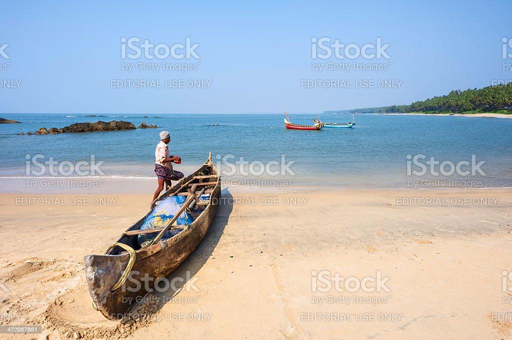 Fisherman preparing to go out on fishing trip, Kerala, India. stock photo