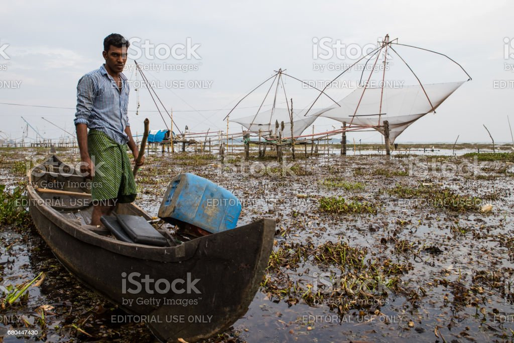 Fisherman returns from a day's work, Kerala, India. stock photo
