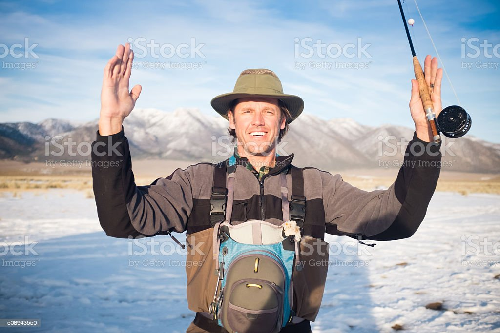 Fisherman Showing How Big The Fish That Got Away Was stock photo