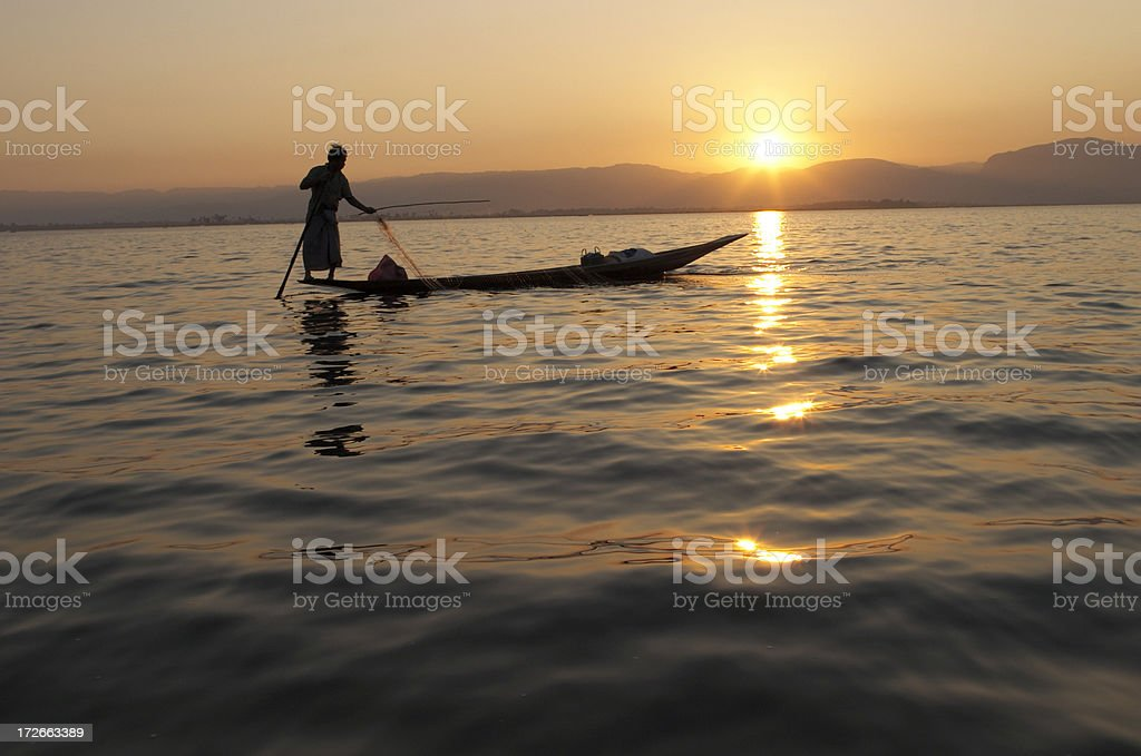 Fisherman Silhouette at Sunset royalty-free stock photo
