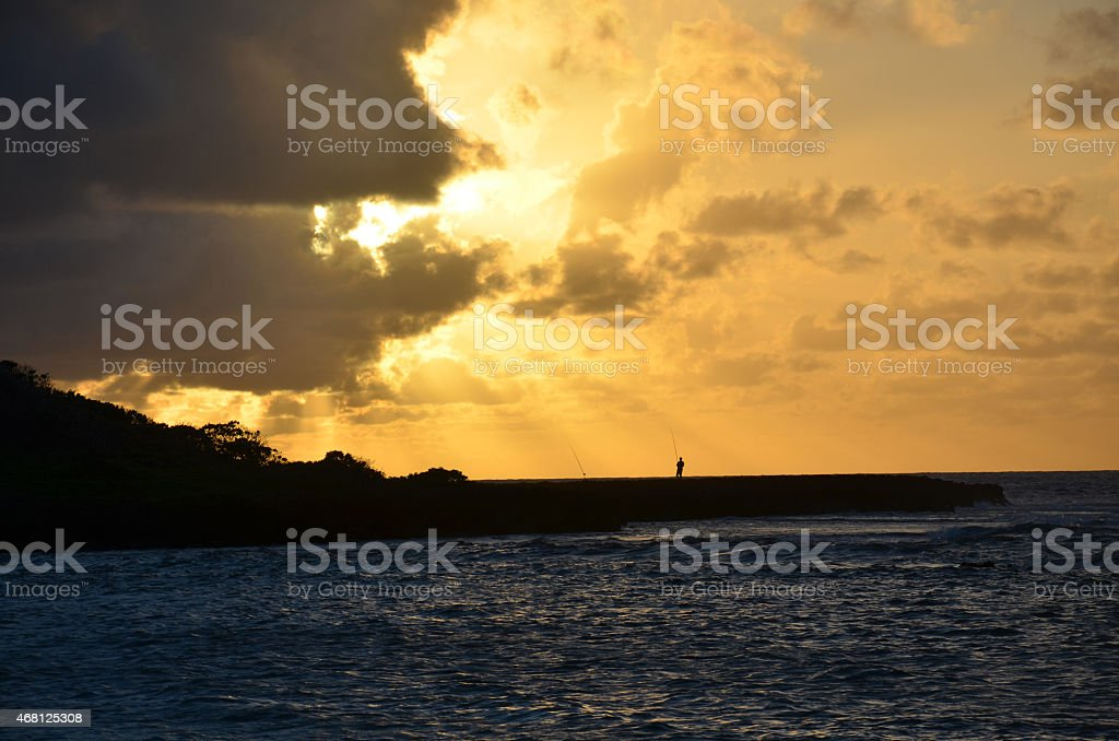 Fisherman Silhouette at sunset stock photo