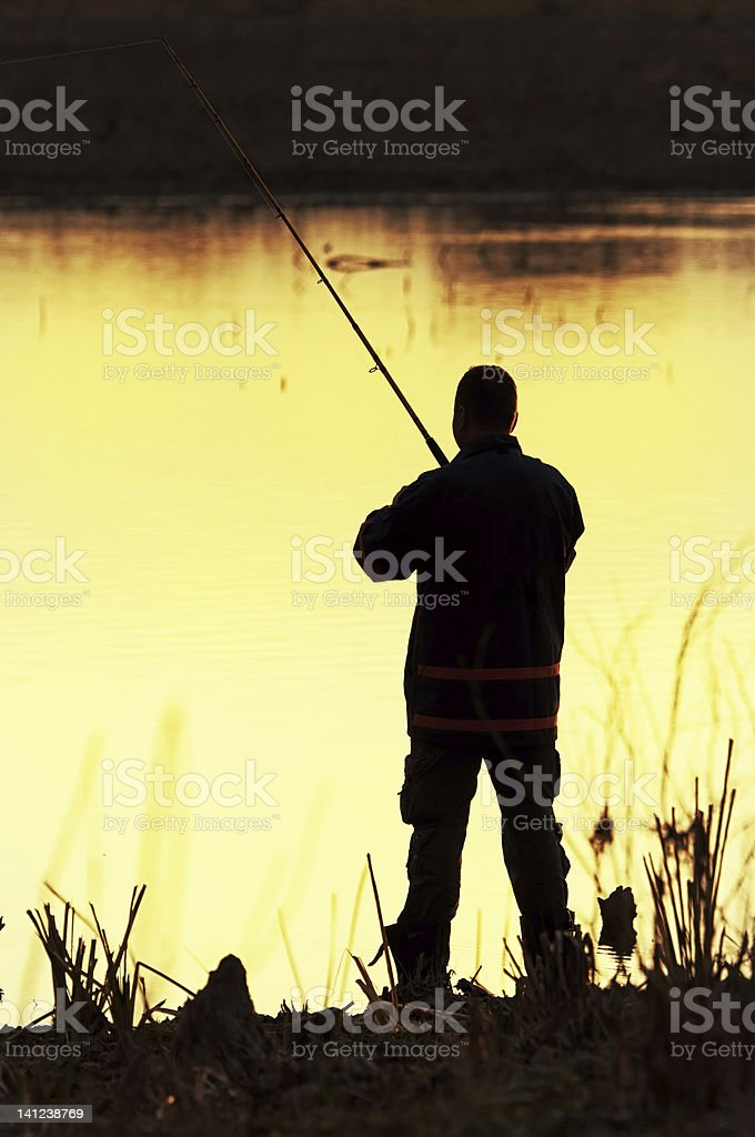 Fisherman silhouette royalty-free stock photo