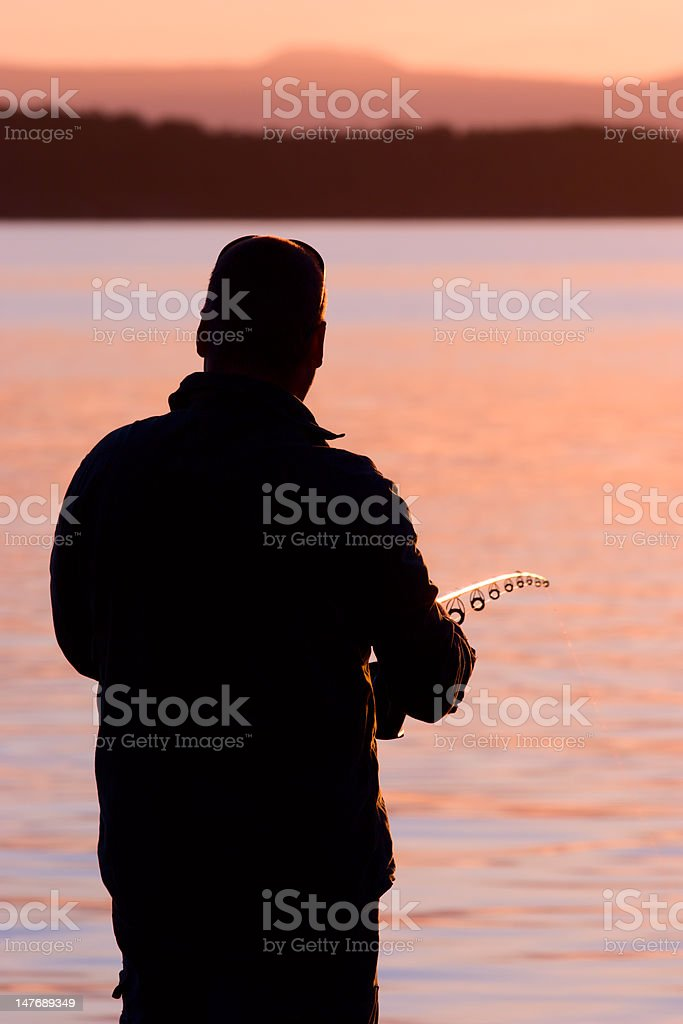 Fisherman silhouette royalty-free stock photo