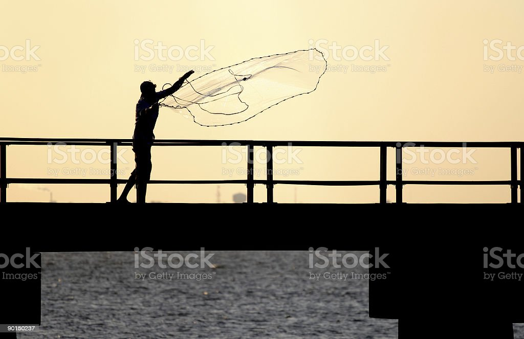 Fisherman tossing net royalty-free stock photo