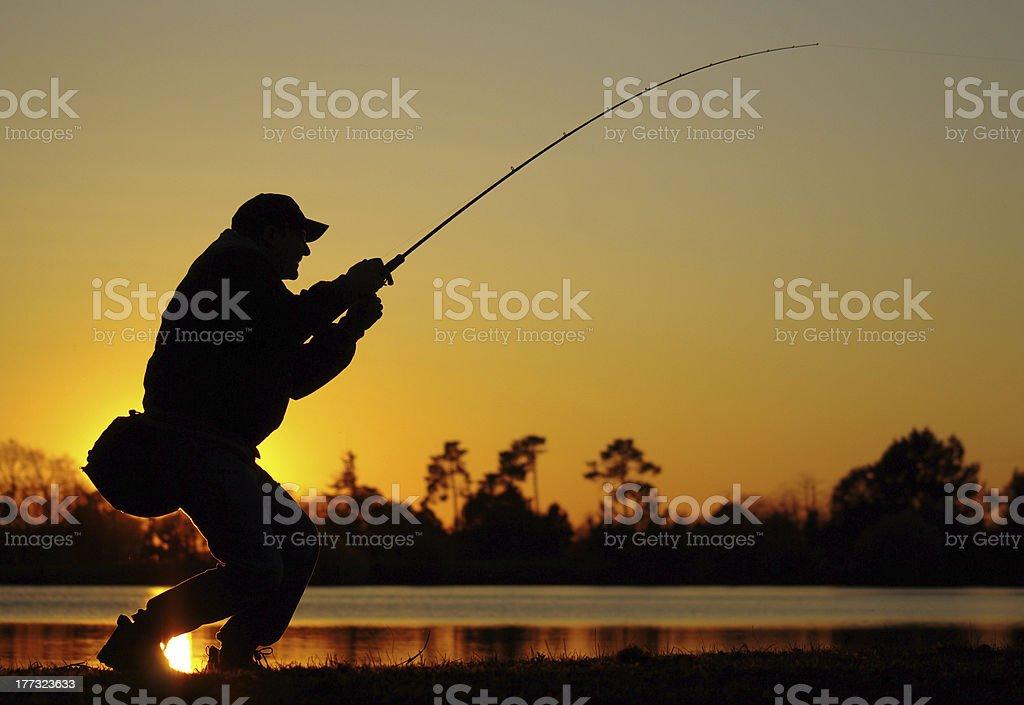 Fisherman vs fish stock photo