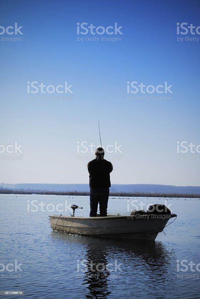 Fisherman Vs Pike stock photo
