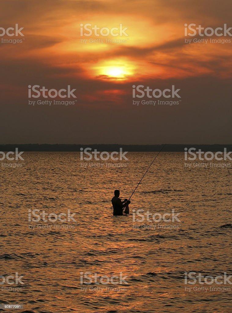 Fisherman wading royalty-free stock photo