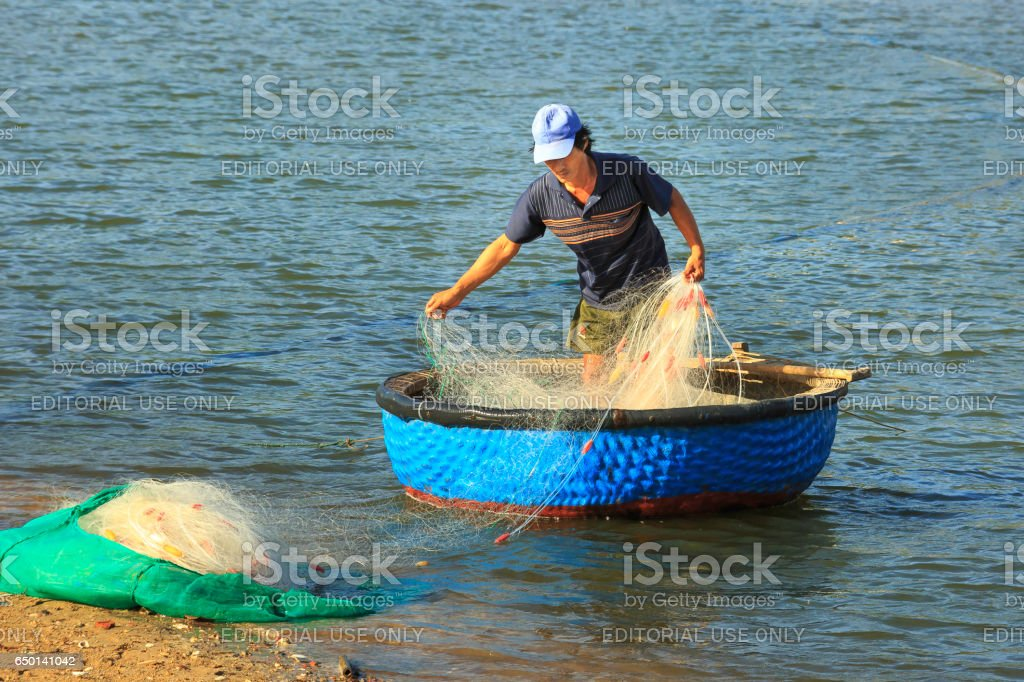 fisherman who arranged their fishing nets to prepare offshore fishing stock photo