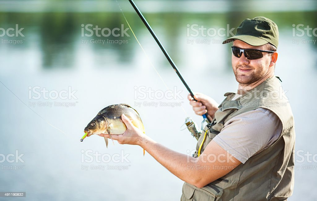 Fisherman with a catch. stock photo