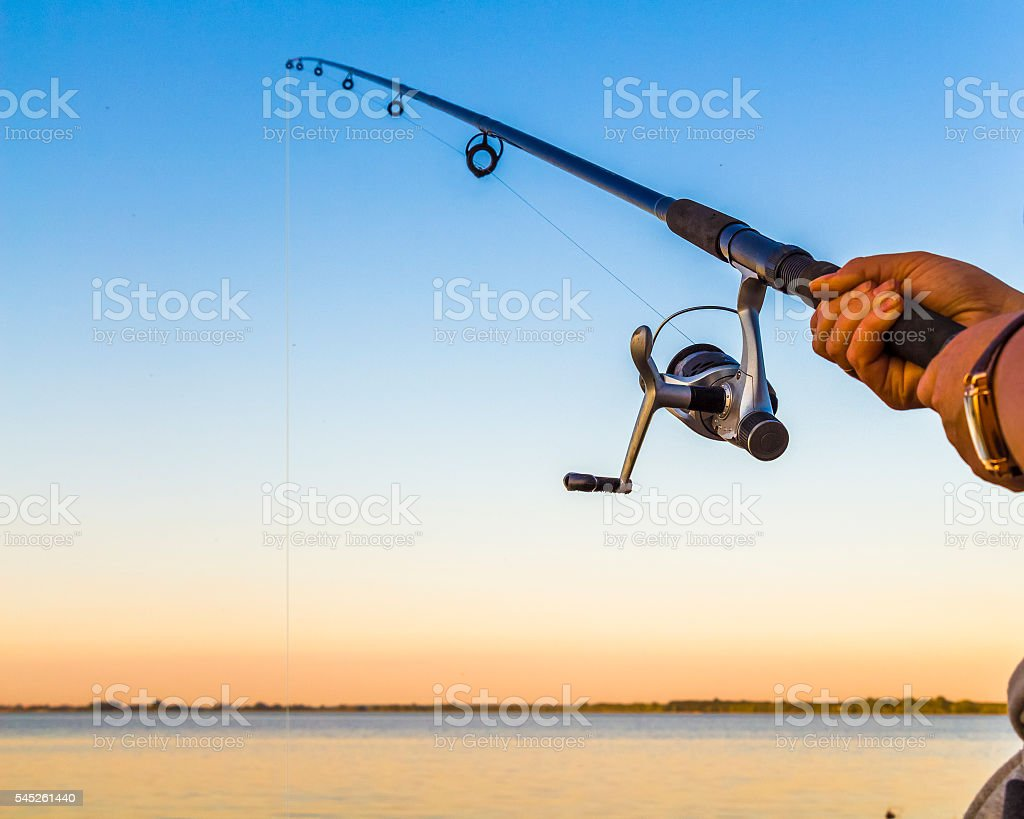 Fisherman with a fishing rod stock photo