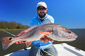 Fisherman with a large redfish
