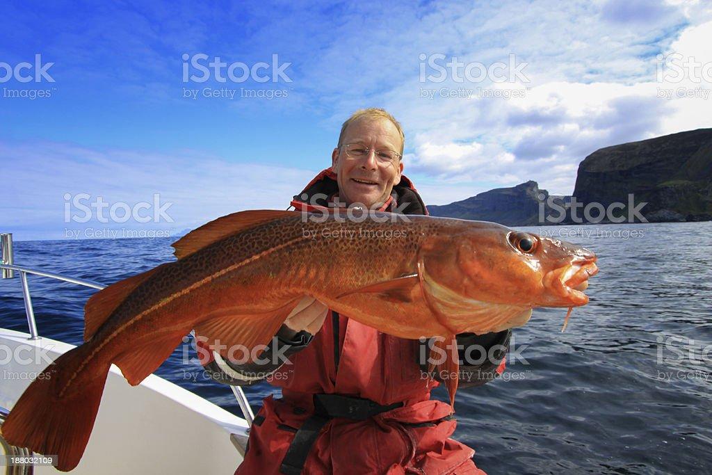 Fisherman with big cod stock photo
