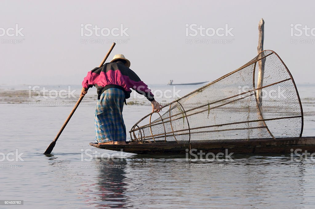 Fisherman with Cone Shaped Net royalty-free stock photo