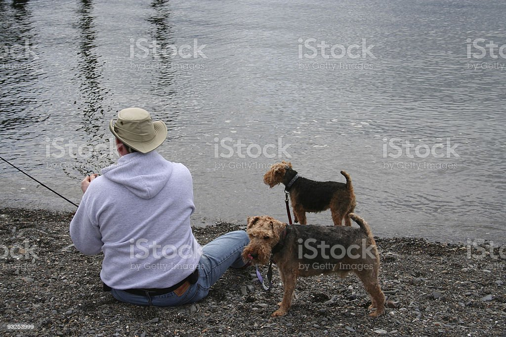 Fisherman with Dogs royalty-free stock photo