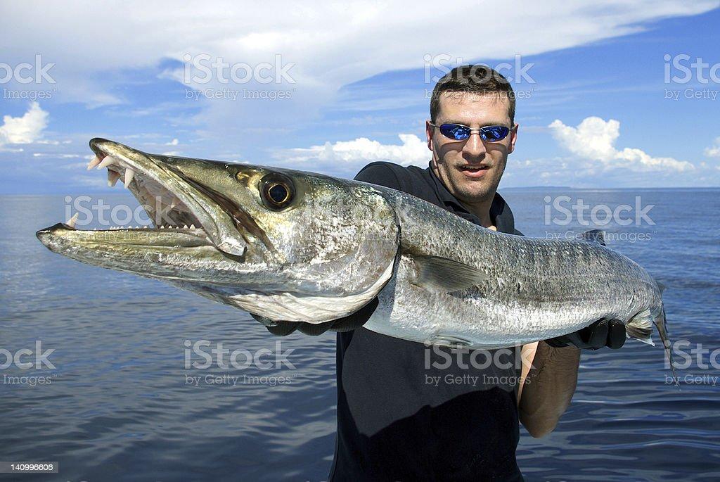 Fisherman with giant barracuda stock photo