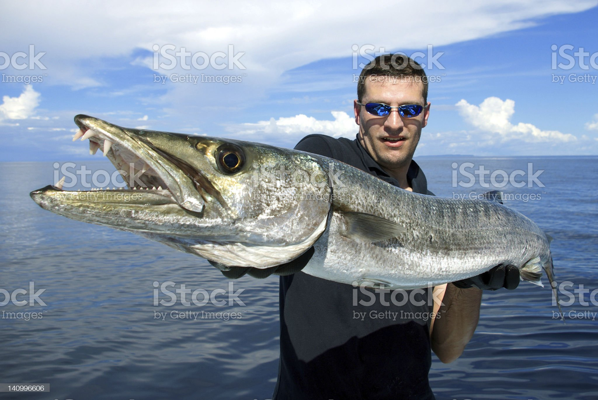Fisherman with giant barracuda royalty-free stock photo