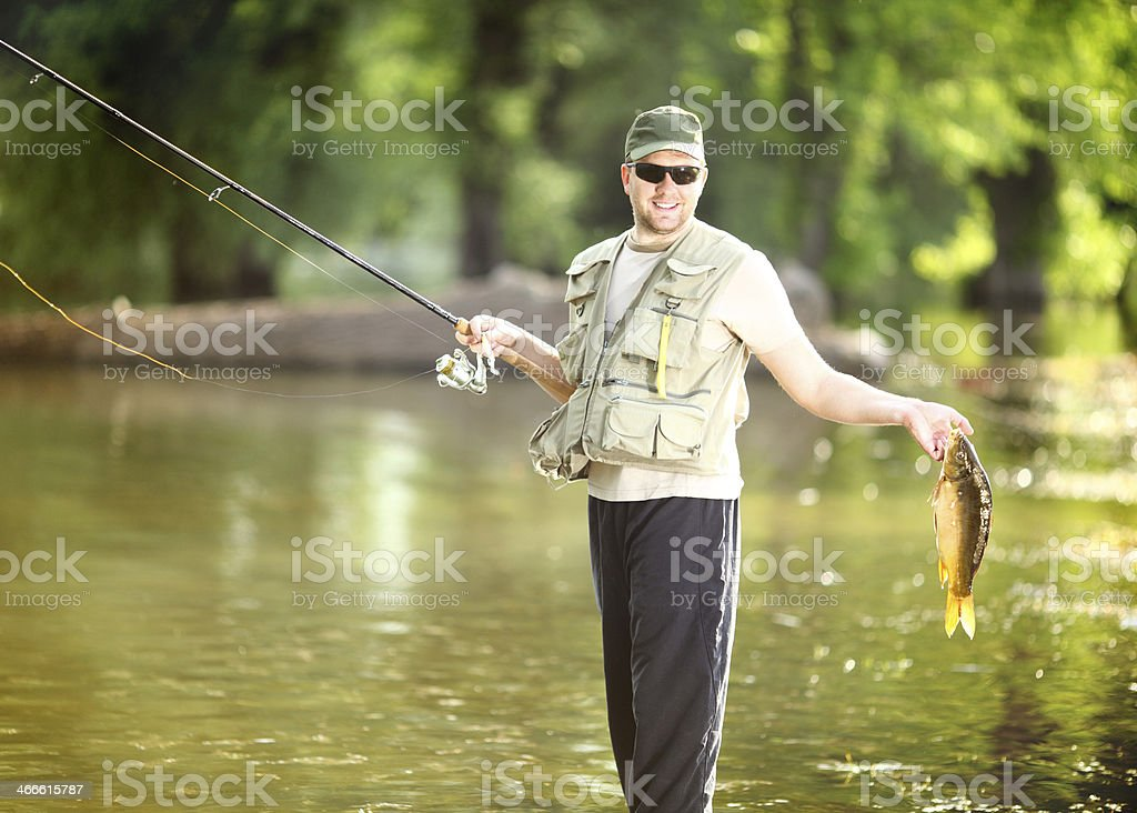 Fisherman with his catch. royalty-free stock photo