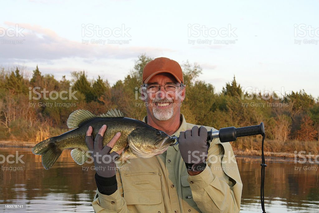 Fisherman with Large Mouth Bass stock photo