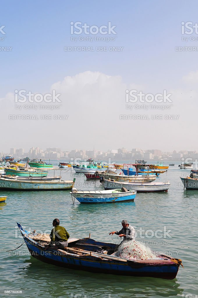 Fisherman with nets in Alexandria Harbor in Egypt stock photo